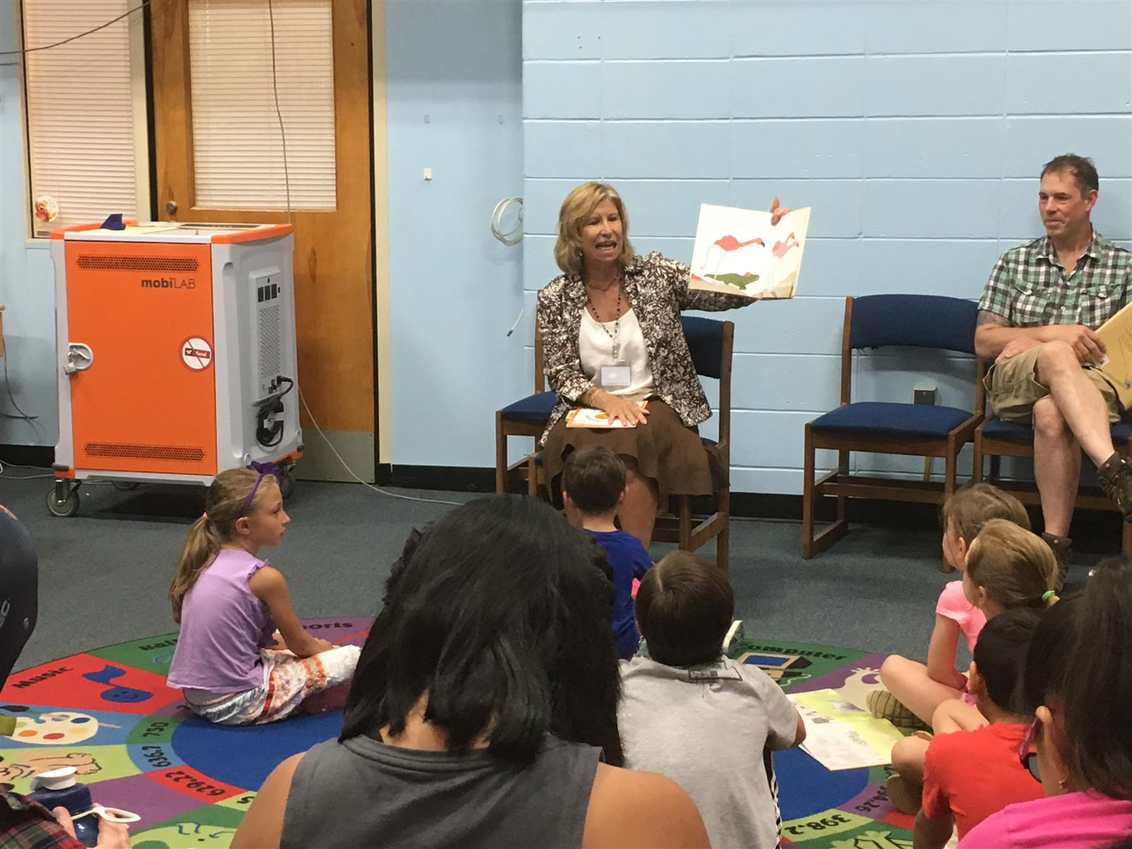 Students Share Their  Favorite Stories with Superintendent Debra Winter